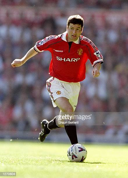 Denis Irwin of Manchester United in action during the FA Carling Premiership match against Leicester City at Old Trafford in Manchester England The...