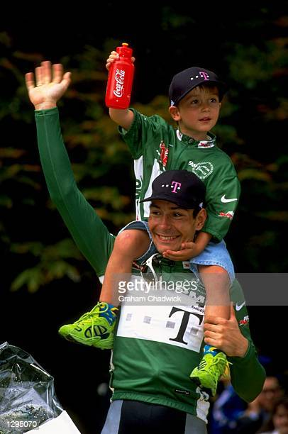 Erik Zabel of Germany wears his Green Jersey with his son on his shoulders during Stage of the 1998 Tour De France between Melun and Paris, France. \...