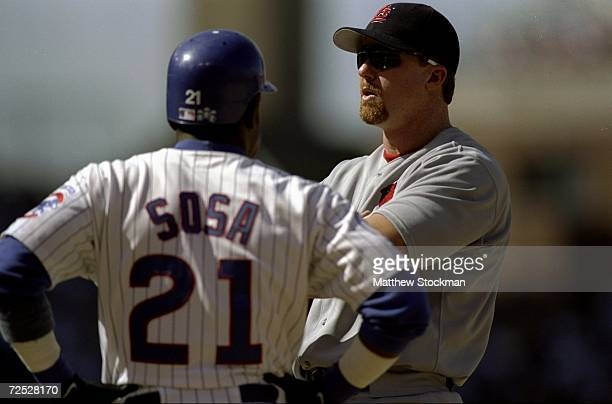 Firstbaseman Mark McGwire of the StLouis Cardinals stands and talks to Sammy Sosa of the Chicago Cubs at Wrigley Field in ChicagoIllinois The...