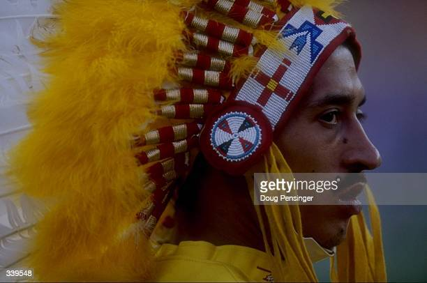 General view of a fan wearing a headdress during a pre-season game between the New England Patriots and the Washington Redskins at the Jack Kent Cook...
