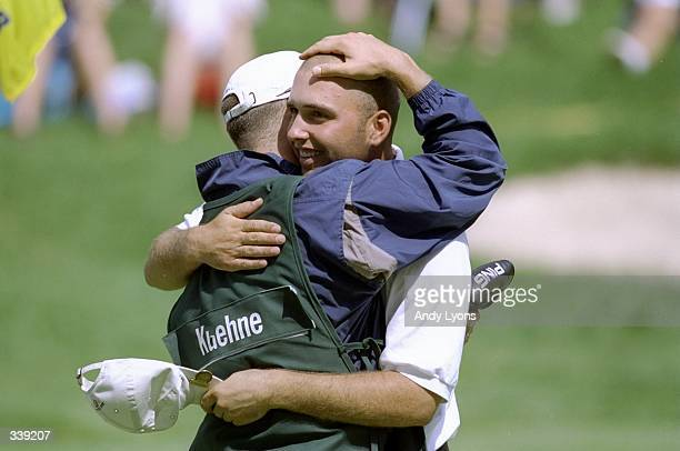 Hank Kuehne hugs Trip Kuehne following a win in the U.S. Amateur Championships at Oak Hill Country Club in Rochester, New York. Mandatory Credit:...