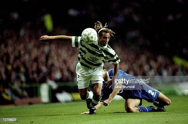Henrik Larsson of Celtic and Sweden fends off a tackle during the qualifiying match between Celtic v Croatia Zagreb in a Champions League Cup played...