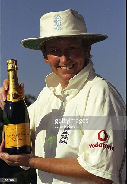 Jan Britten of England receives a bottle of champagne after breaking Rachel HeyhoeFlint's record for the most number of test runs during the 1st Test...