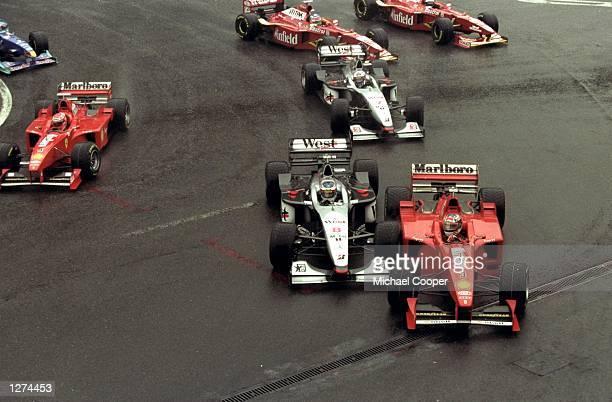Mika Hakkinen of Finlands Maclaren Mercedes collides with Michael Schumacher of Germanys Ferrari during the Belgian Grand Prix at Spa-Francorchamps...