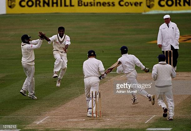 Muttiah Muralitharan of Sri Lanka takes the wicket of Darren Gough of England during the test match against England at the Oval in London, England....