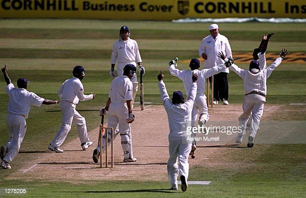 Muttiah Muralitharan of Sri Lanka takes the wicket of Ian Salisbury of England during the test match against England at the Oval in London, England....