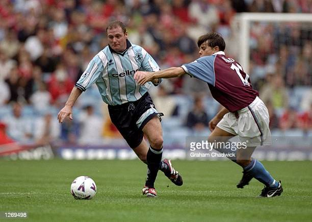 Paul Gascoigne of Middlesbrough goes past Lee Hendrie of Aston Villa during the FA Carling Premiership match at Villa Park in Birmingham England...