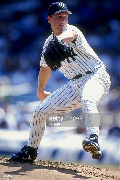 Pitcher David Cone of the New York Yankees winds up to throw during a game against the Minnesota Twins at Yankee Stadium in Bronx New York The...