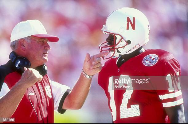 Quarterback Bobby Newcombe of the Nebraska Cornhuskers talks to a coach during the Eddie Robinson Classic game against the Louisiana Tech Bulldogs at...