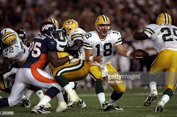 Quarterback Doug Pederson of the Green Bay Packers in action during the preseason game against the Denver Broncos at the Mile High Stadium in Denver...