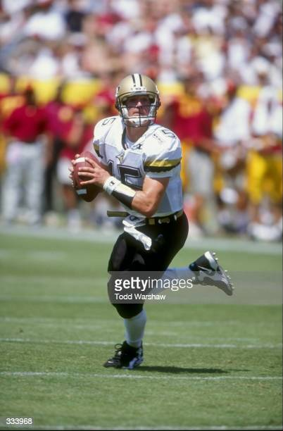 Quarterback Drew Brees of the Purdue Boilermakers looks for an open receiver during the Pigskin Classic against the USC Trojans at the Memorial...
