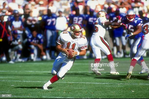 Quarterback Ty Detmer of the San Francisco 49ers in action during a preseason game against the New England Patriots at the 3Com Park in San Francisco...