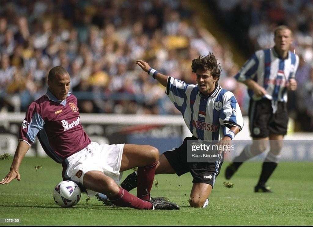 Rio Ferdinand and Benito Carbone : News Photo
