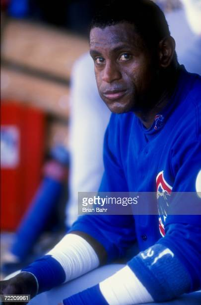 Sammy Sosa of the Chicago Cubs looks on from the dugout during a game against the Colorado Rockies at Coors Field in Denver Colorado The Cubs...