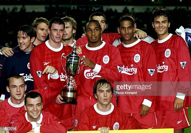 The Liverpool team celebrate winning the Pirelli trophy after the preseason friendly against Inter Milan at Anfield in Liverpool England Liverpool...