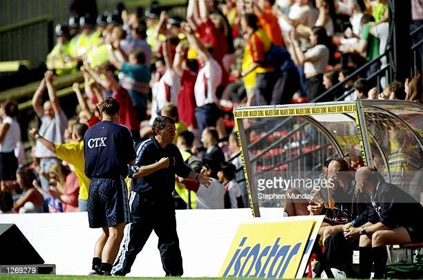 Watford Manager Graham Taylor talks to the players on the bench during a Nationwide League Division One match against Bradford City at Vicarage Road...