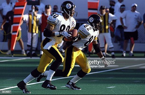 Wide Receiver Jahine Arnold of the Pittsburgh Steelers running with ball with Henry Bailey next to him during the Pro Football Hall of Fame Game...