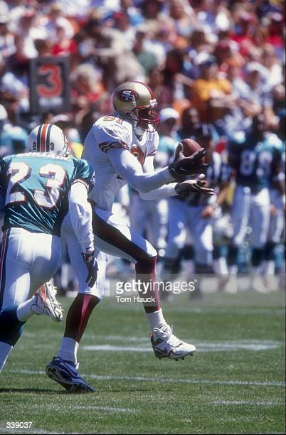 Wide receiver Terrell Owens of the San Francisco 49ers in action against cornerback Patrick Surtain of the Miami Dolphins during the preseason game...