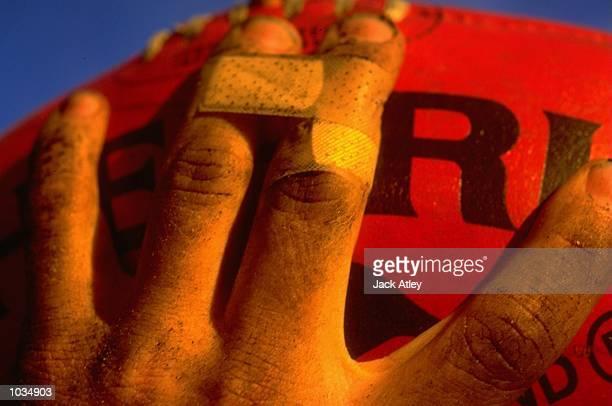A general view of an AFL footballer holding an official Sherrin football Mandatory Credit Jack Atley /Allsport