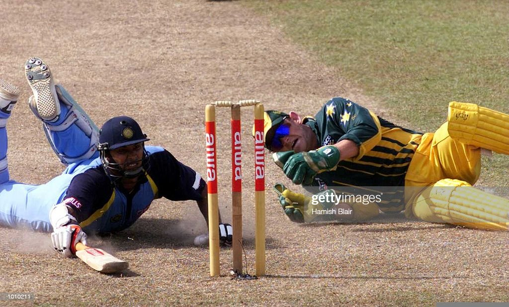 Adam Gilchrist of Australia falls over in an attempt to run out Robin Singh of India, during the match between India and Australia at Singhalese Stadium, Colombo, Sri Lanka. Mandatory Credit: Hamish Blair/ALLSPORT