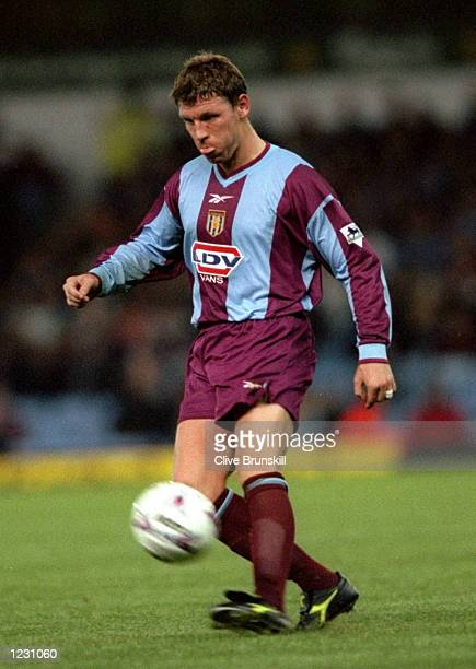 Alan Thompson of Aston Villa chips forward in the FA Carling Premiership match against West Ham United at Villa Park in Birmingham England The game...
