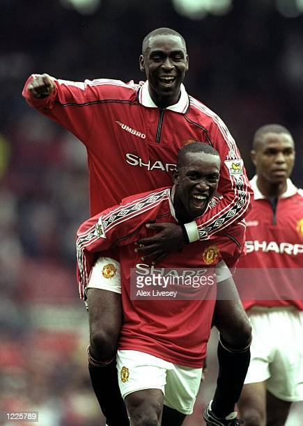 Andy Cole of Manchester United celebrates a goal with team mate Dwight Yorke during the FA Carling Premiership match against Newcastle United at Old...
