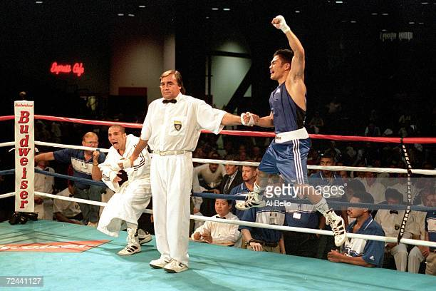 Brian Viloria of the USA celebrates his victory over Maikro Romero of Cuba during the World Boxing Championships at the George Brown Convention...