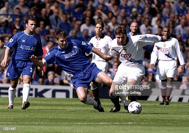 Chris Sutton of Chelsea tackles Alan Thompson of Aston Villa during the FA Carling Premiership match played at Stamford Bridge in London England...