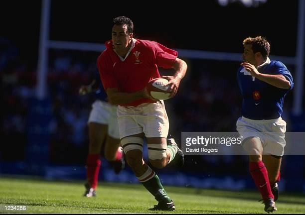 Chris Wyatt of Wales takes on Christophe Dominici of France in the World Cup warm up match at the Millennium Stadium in Cardiff Wales Wales won the...