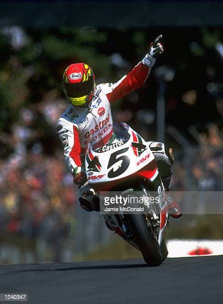 Colin Edwards of the USA salutes the crowd following a win on his Castrol Honda during the World Superbike Championships at Brands Hatch in Kent...