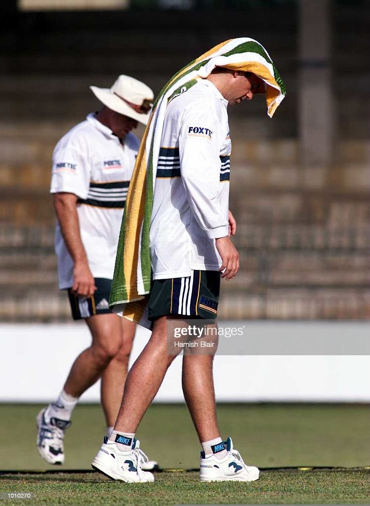 Colin Miller shading himself from the sun with a towel, during Australian test team training at Premadasa Stadium, Colombo, Sri Lanka. Mandatory Credit: Hamish Blair/ALLSPORT