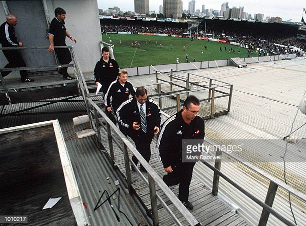Collingwood coach Tony Shaw with his coaching staff leave the coaching box at three quarter time to adress his players for the last timeVictoria Park...