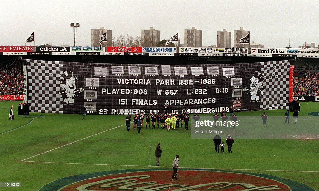 Collingwood players prepare to run through the banner for the final game at Victoria Park Collingwood before the AFL round 22 game Collingwood v Brisbane at Victoria Park Collingwood,Victoria,Australia.Brisbane defeated Collingwood. Mandatory Credit: Stuart Milligan/ALLSPORT