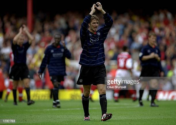 David Beckham of Manchester United applauds the fans after the FA Carling Premiership match against Arsenal played at Highbury in London England The...