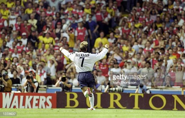 David Beckham of Manchester United celebrates his goal during the FA Charity Shield match against Arsenal played at Wembley Stadium in London England...