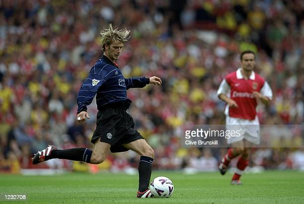 David Beckham of Manchester United in action during the FA Carling Premiership match against Arsenal played at Highbury in London England The match...