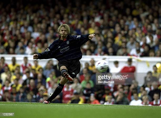 David Beckham of Manchester United shoots at goal during the FA Carling Premiership match against Arsenal played at Highbury in London England The...