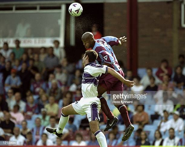Dion Dublin of Aston Villa wins the header during the FA Carling Premiership match against Middlesbrough at Villa Park in Birmingham England...