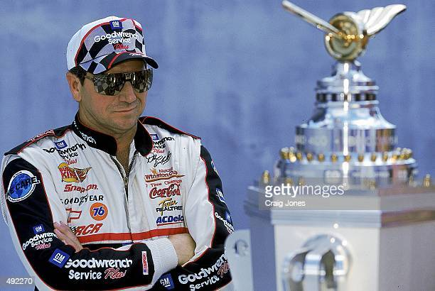 Driver Dale Earnhardt poses with the trophy before the Brickyard 400 part of the NASCAR Winston Cup Series at the Indianapolis Motor Speedway in...