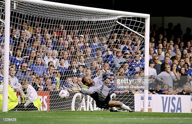 Ed De Goey of Chelsea dives in vain to stop the penalty kick from Leicester's Muzzy Izzet during the FA Carling Premiership match against Leicester...