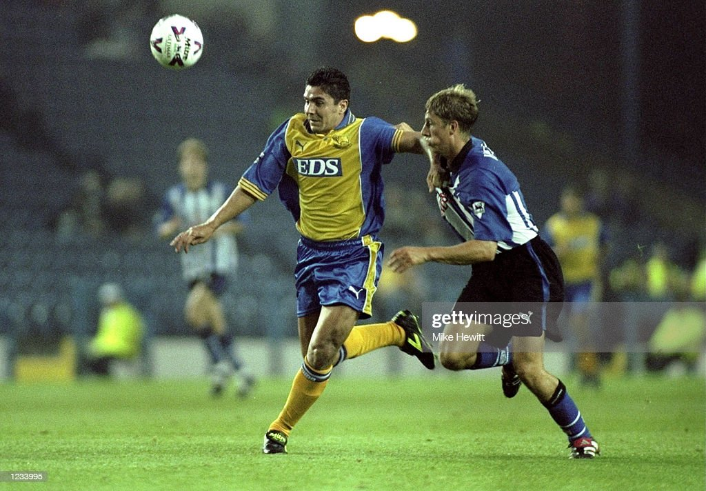 Esteban Fuertes of Derby battles with Steven Haslam of Wednesday during the match between Sheffield Wednesday v Derby County in the FA Carling Premiership played at Hillsborough, Sheffield. Derby won the game 2-0. \ Mandatory Credit: Mike Hewitt /Allsport