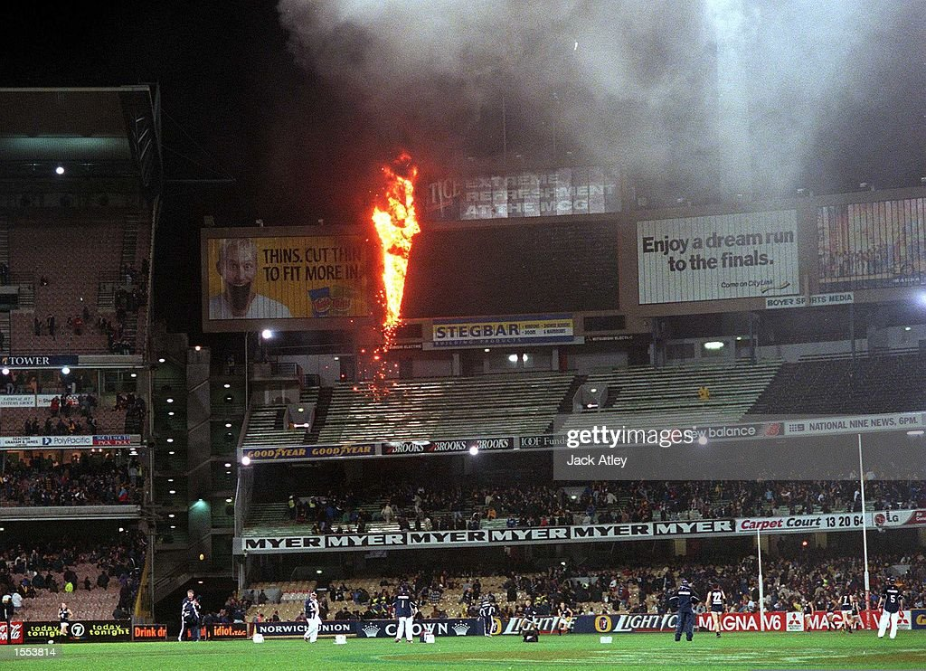 Fire destroys the main MCG scoreboard as players and officials warm up on the ground before the round 22 AFL game between Richmond and Carlton. Mandatory Credit: Jack Atley/ALLSPORT