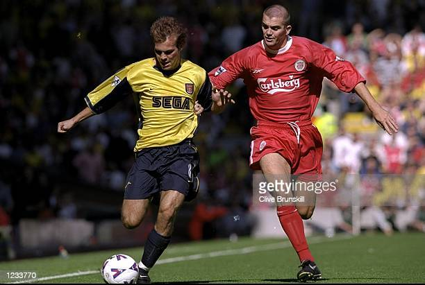 Fredrik Ljunberg of Arsenal is challenged by Dominic Matteo of Liverpool during the FA Carling Premiership match played at Anfield in Liverpool...