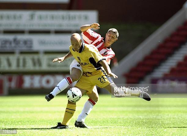 Graham Kavanagh of Stoke City in action against Paul Shaw of Millwall during the Nationwide Division Two match against Millwall played at the...