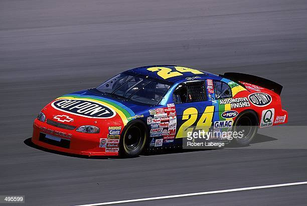 Jeff Gordon speeds down the track during the Pepsi 400, part of the Winston Cup Series, at the Michigan International Speedway in Brooklyn, Michigan....