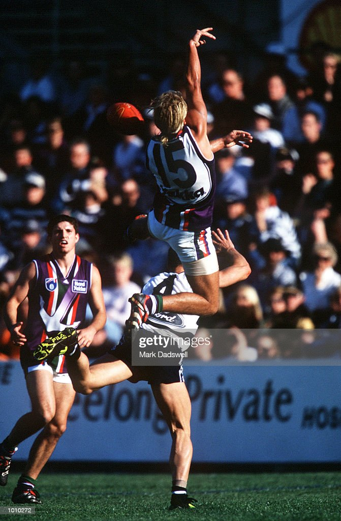 Jess Sinclair #15 for Fremantle flies over Jason Snell #4 for Geelong, as he attempts to mark during the round 22 match of the AFL season. Geelong defeated Fremantle in the match played at Shell Stadium, Geelong, Victoria, Australia. Mandatory Credit: Mark Dadswell/ALLSPORT