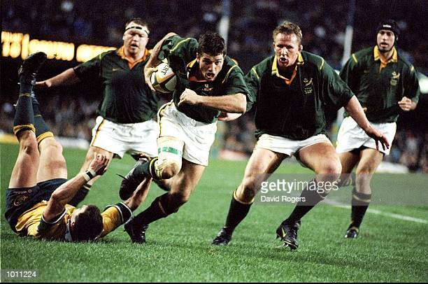Joost van der Westhuizen of South Africa breaks for the tryline during the TriNations rugby union international between South Africa and Australia...