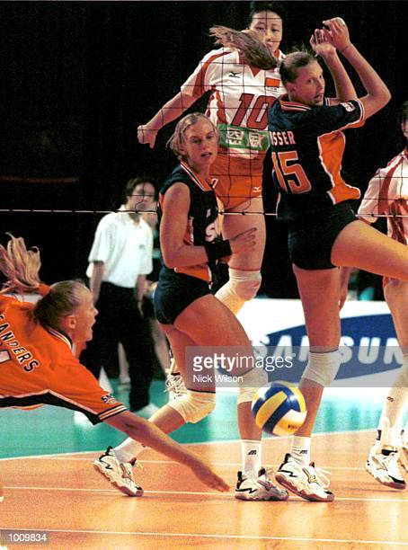 Kitty Sanders of Netherlands tries to keep the ball alive as Ingrid Visser looks on against China during the NSW International Volleyball at the...