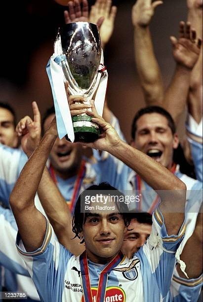 Lazio captain Alessandro Nesta lifts the trophy after Lazio won the UEFA Super Cup match beating Manchester United at the Stade Louis II stadium...