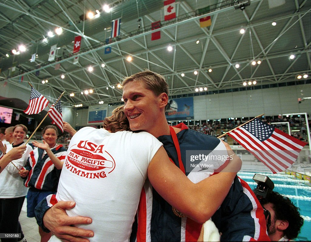 Lenny Krayzelburg of the USA celebrates with team mate Jenny Thompson winning the gold medal in the 100 metres backstroke in a New World Record time of 53.60 seconds at the Pan Pacific Swimming Championships at the Aquatic Centre, Homebush, Sydney, Australia. Mandatory Credit: Nick Wilson/ALLSPORT
